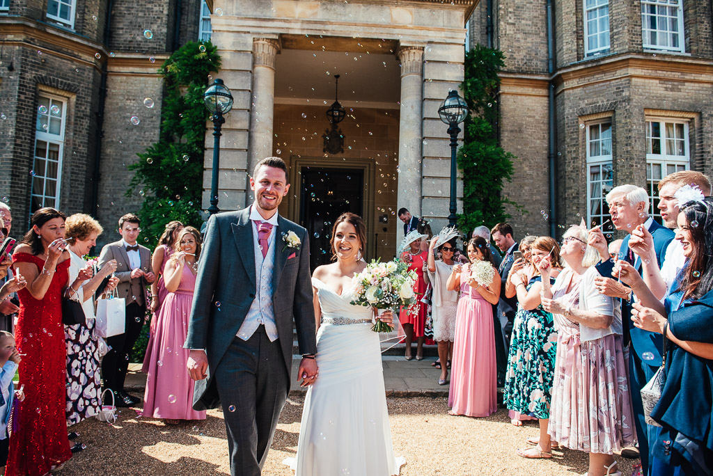 Bubble confetti exit for the bride and groom at Hedsor House