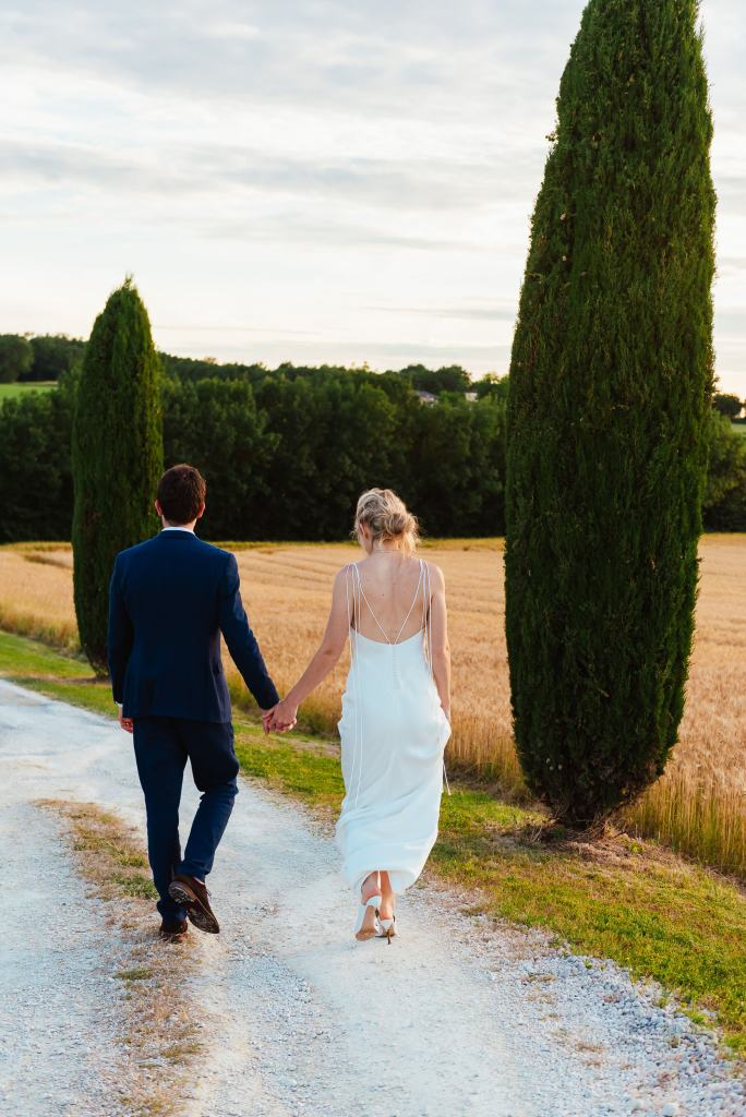 Couple walk together int he Parisian sunset, destination wedding photography