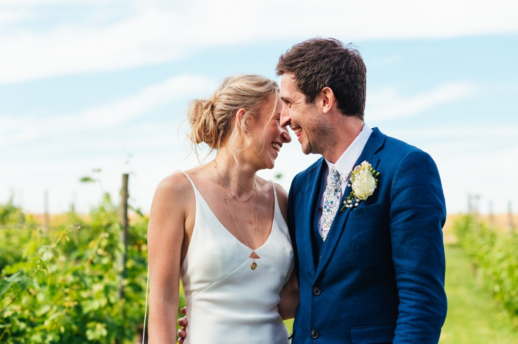 Natural and relaxed wedding portrait surrounded by French vineyards