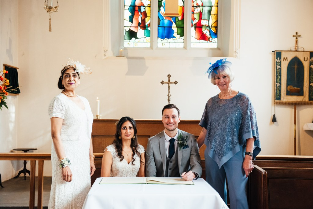 The couple and their families sign the marriage register