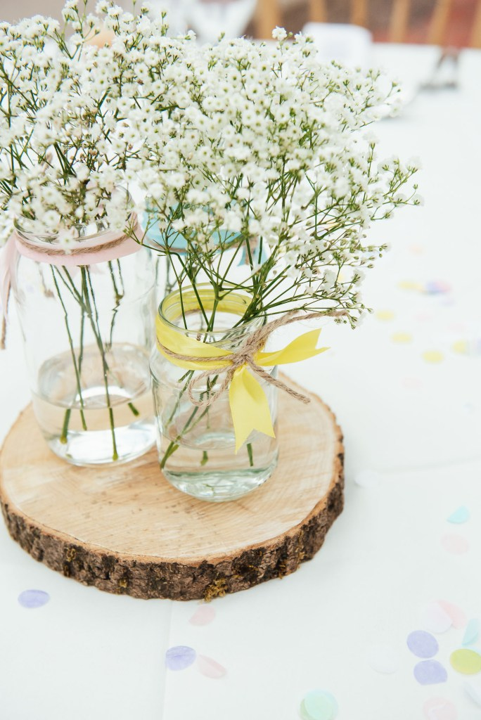 Rustic wooden table setting with soft white flower floral decoration
