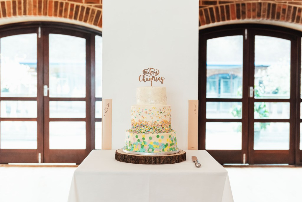 Three tier homemade wedding cake with confetti decoration