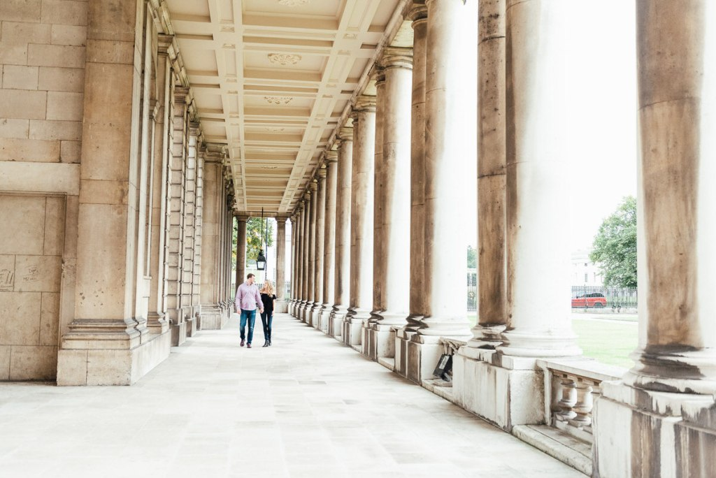 Natural and candid couple walking together in Greenwich Old Naval College