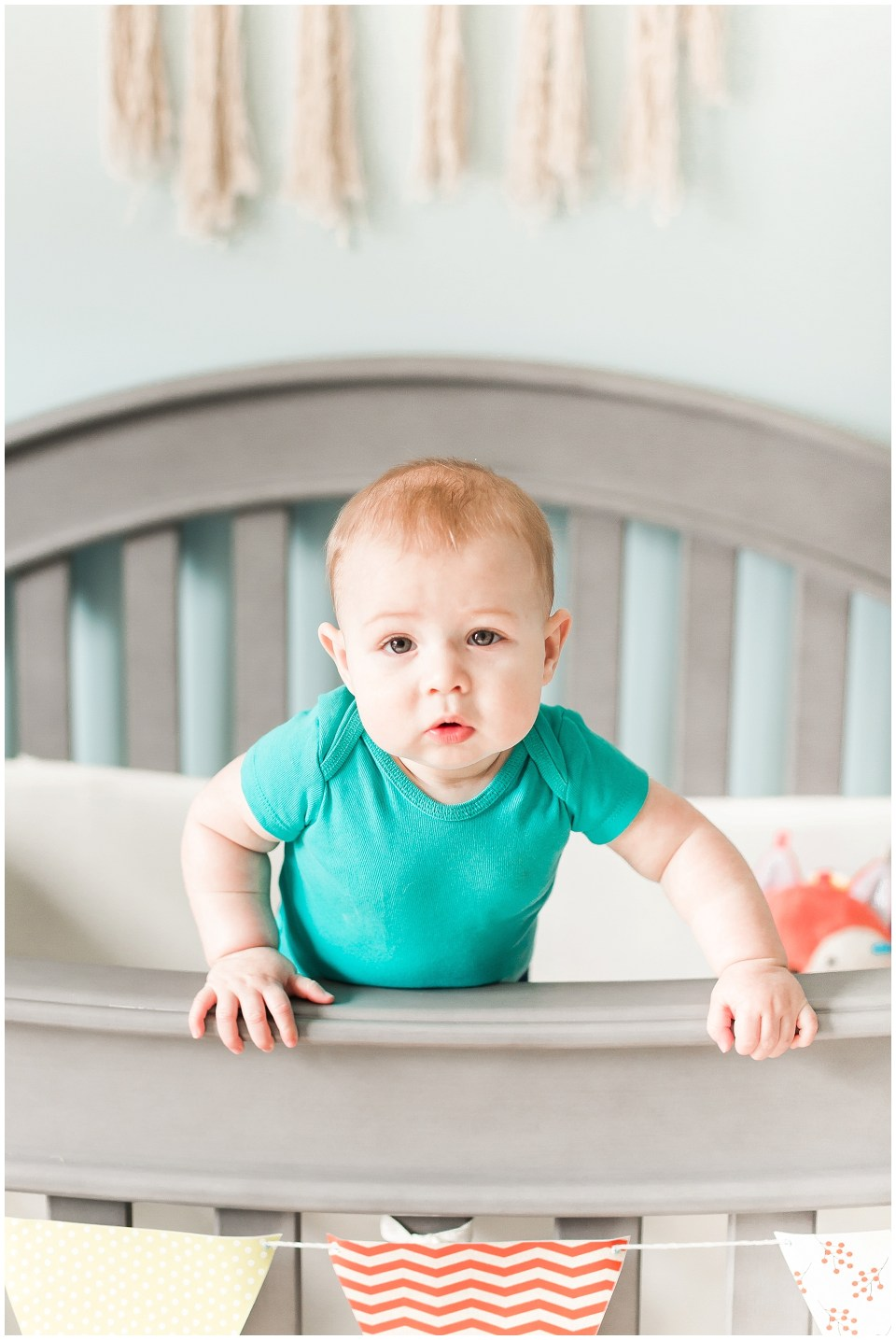 Baby Standing in Crib Photo