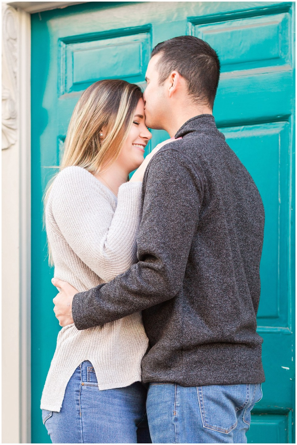 Forehead kissing photo in downtown Leesburg for an engagement session