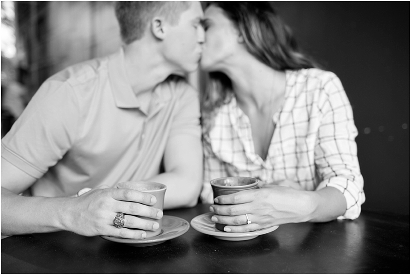 Black and white couple kissing at drip coffee