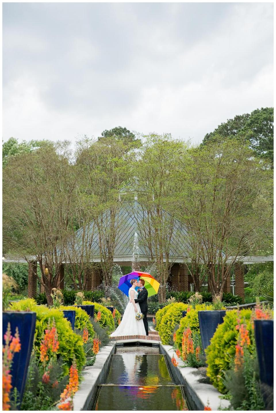 Columbia, SC LGBTQ Friendly Couple with Rainbow Umbrella at Riverbanks Zoo Botanical Gardens