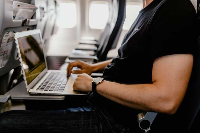 professional blog writer sitting on a plane