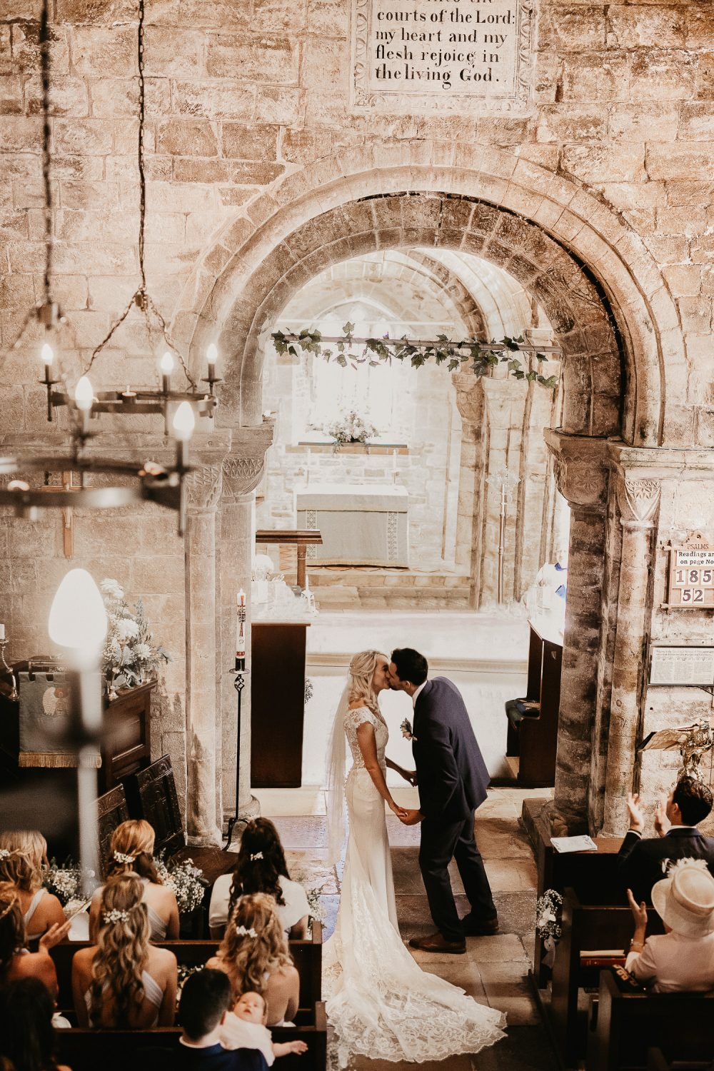 Couple kissing at Wedding ceremony in Studland bay