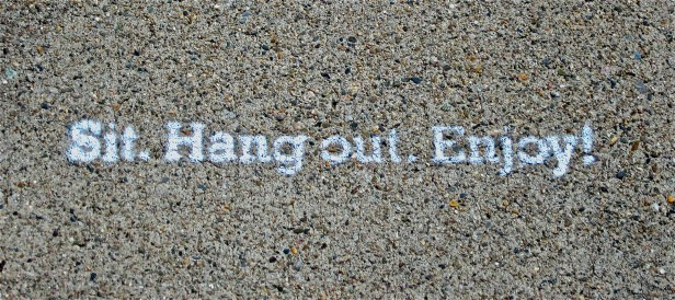 A phrase painted on the sidewalk outside Mei Mei Kitchen and reflects the casual vibe inside the restaurant.
