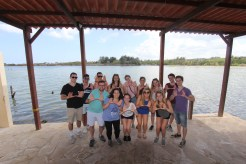 University of Miami Hillel students visited Cuba in March 2017 for an Alternative Spring Break. They engaged with the Cuban Jewish community, and visited cultural and historic sites. Here, the students, with Rabbi Lyle Rothman, front row, far left, throw up the U in the bay of Cojimar, a small fishing village east of Havana that was the inspiration for Ernest Hemingway's Nobel prize-winning The Old Man and the Sea. Photo credit: Jessica M. Castillo