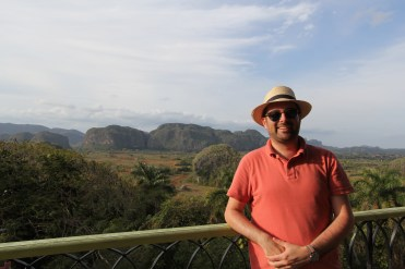 UM Hillel's Campus Rabbi, Lyle Rothman, was the only known rabbi in Cuba while taking UM Hillel students on an Alternative Spring Break trip to the island in March 2017. Here, he poses in front of the distinct rounded mountains in Valle de Vinales in the Pinar del Rio province. Photo credit: Jessica M. Castillo