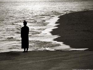 Solitude woman in shadow on a beach