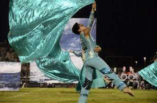 Aiden Kelly with the Braden River color guard performs during half time of his school's biggest rivalry game of the year against Lakewood Ranch High School.