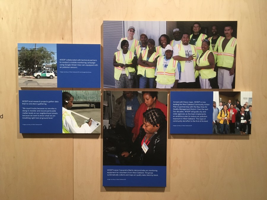 A museum wall panel of 5 photographs of WOEIP volunteers measuring air quality in various settings in West Oakland.