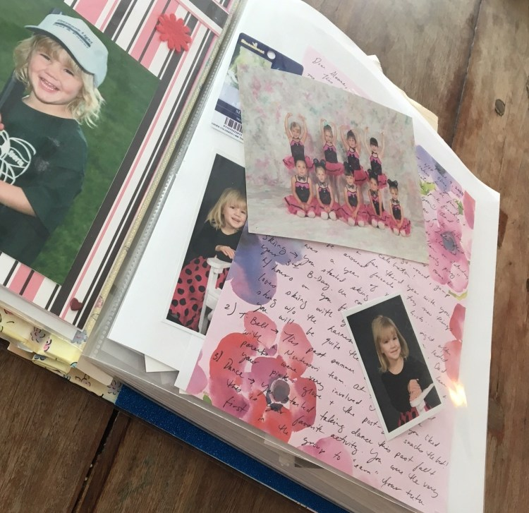 Image of book filled with letter, photo, etc - best baby gift
