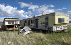 A trashed mobile home offered up for free.
