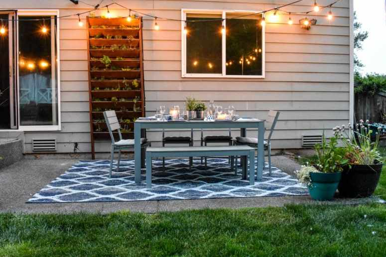 photo of outdoor dining room with string lights