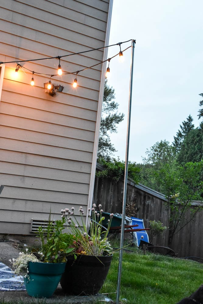 easy diy string light poles tutorial