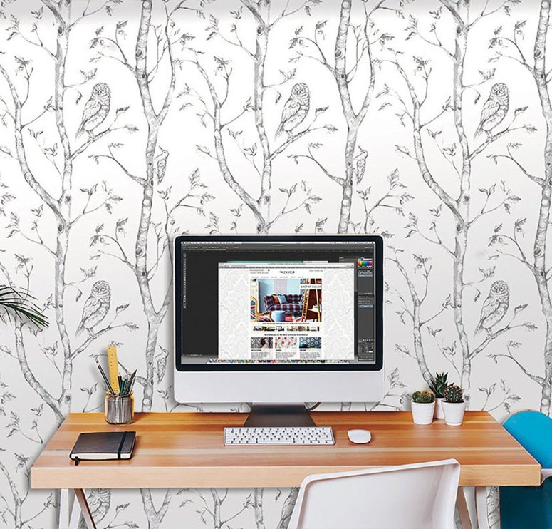 white wallpaper with trees and owls with computer desk and chair