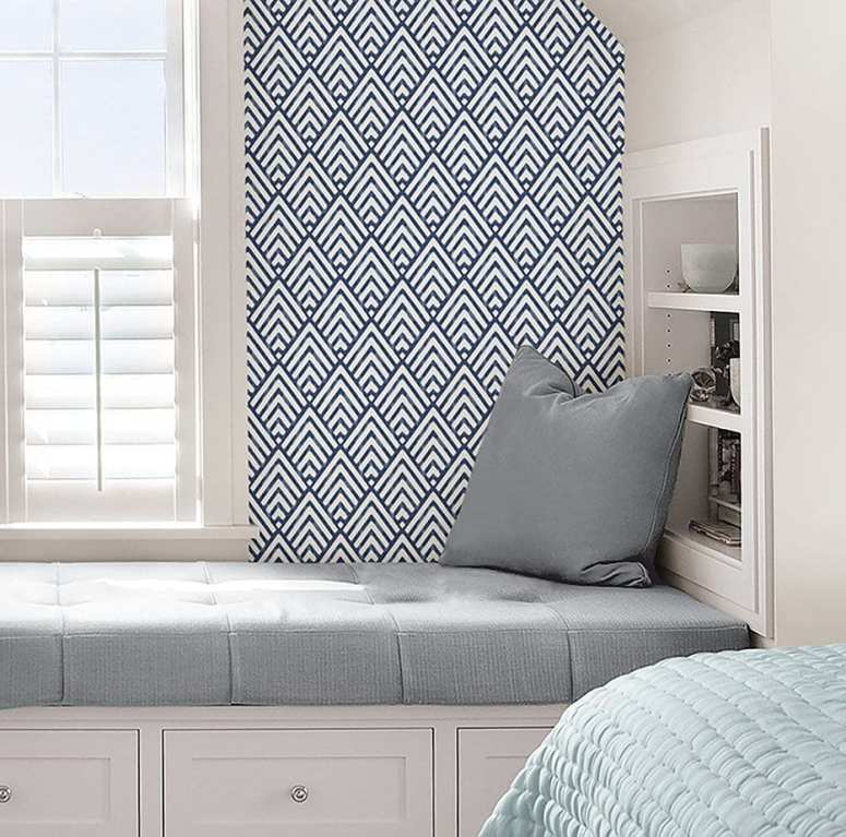 photo of window seat with blue and white geometric wallpaper