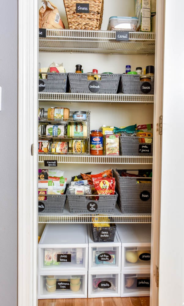 photo of organized pantry with chalkboard labels