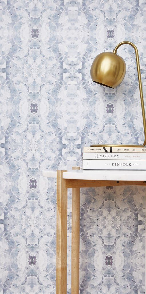 photo of blue and white wallpaper with gold desk lamp