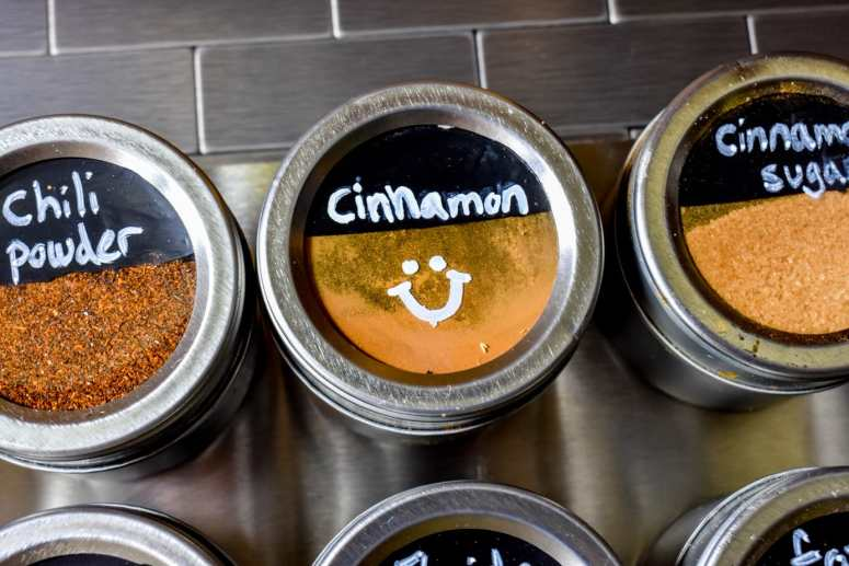 photo of magnetic spice rack with cinnamon tin