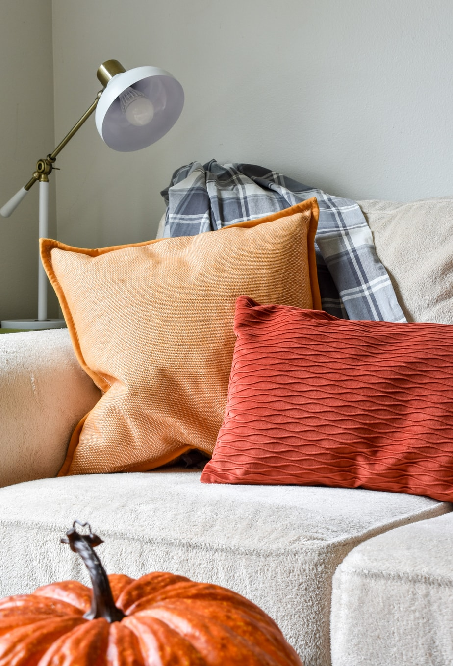 photo of cozy Fall throw pillows and blankets