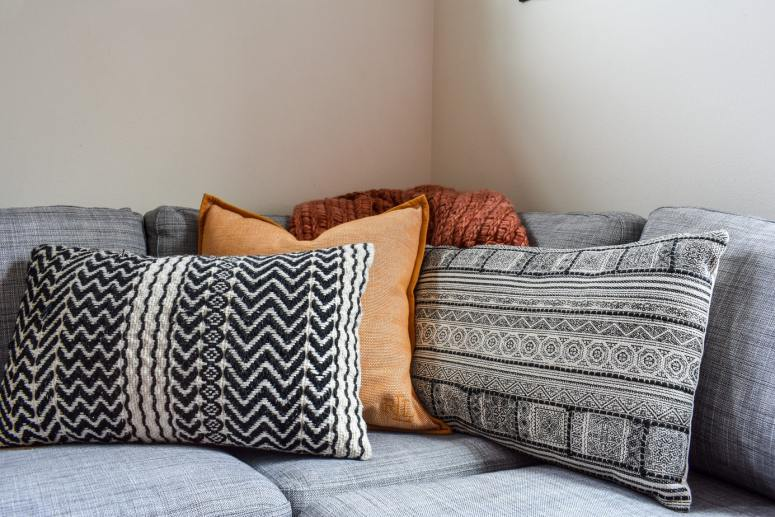 photo of cozy Fall throw pillows and blankets on sofa