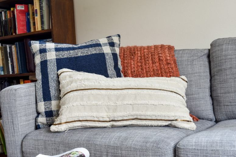 photo of cozy Fall throw pillows and blanket on sofa