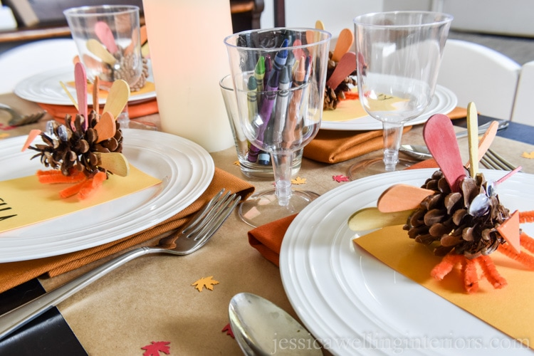 image of Thanksgiving kids table with pine cone turkeys and crayons