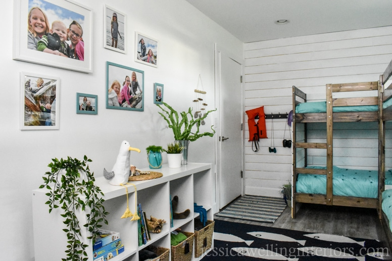 DIY beach house bunk room with photo gallery wall, IKEA Kallax bookshelf with toys and books