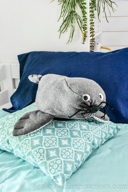 homemade stuffed seal on a bunk bed in a beach house