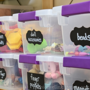 stacked containers of toys with chalkboard labels