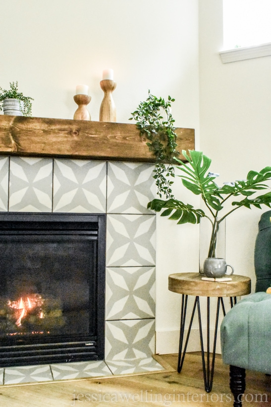 modern fireplace makeover with stenciled tiles in large modern pattern in grey and white