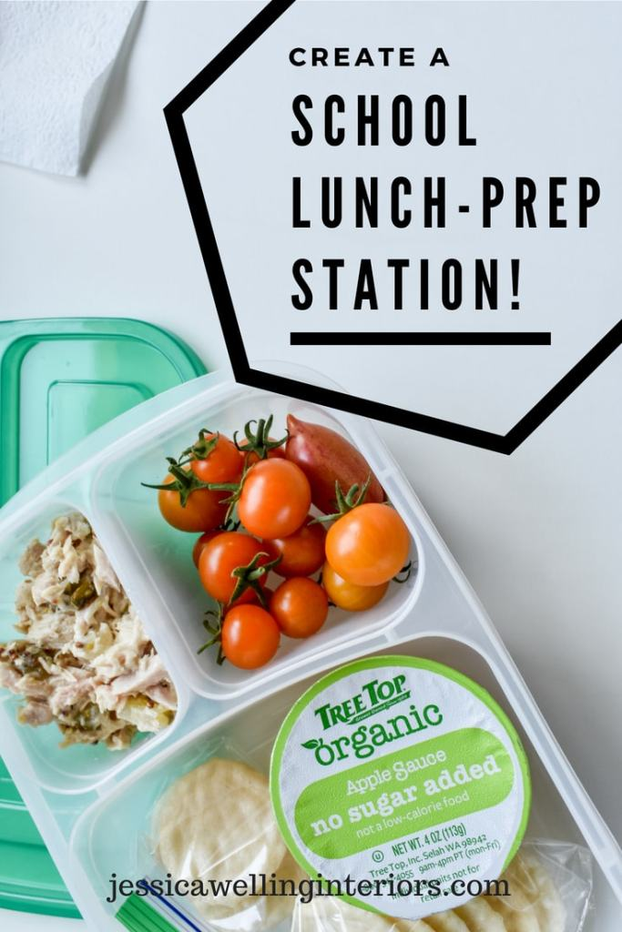 Create a School Lunch-Prep Station! Bento-style lunch container with organce cherry tomatoes, tuna salad, an applesauce cup, and rice crackers