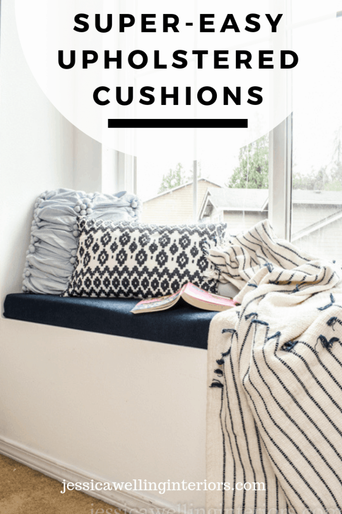 Super-Easy Upholstered Cushions: window seat with navy upholstered bench cushion, two throw pillows, a blanket, and a book