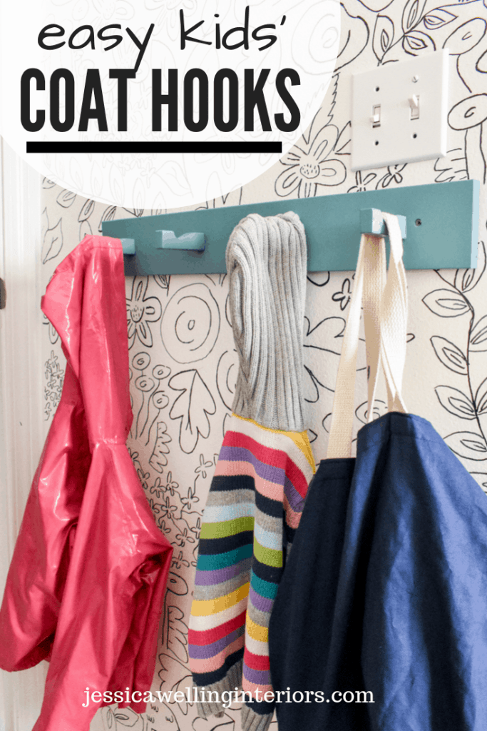 Easy Kids' Coat Hooks: aqua-painted modern coat hooks rack from Ikea with children's rain coat, sweater, and bag hanging from it