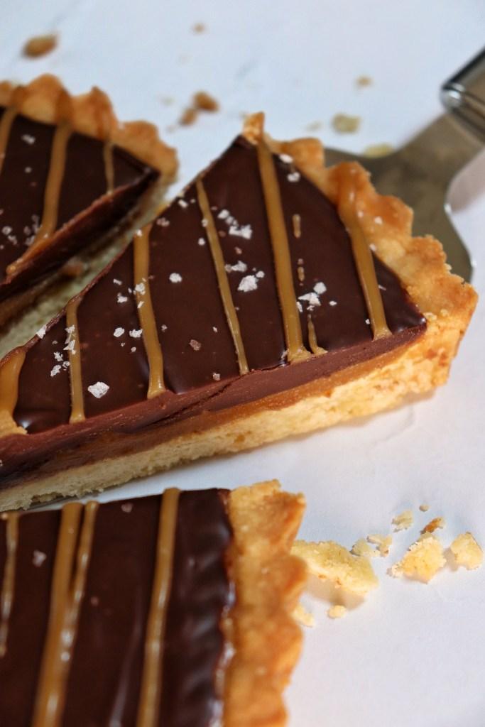 Slice of millionaire's salted caramel tart