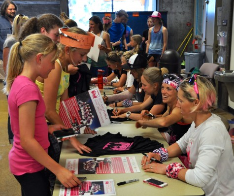 Fast and Female participants getting their posters signed by Winter Olympians!