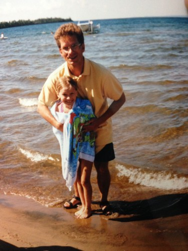 My Dad wrapping me up after I nearly went hypothermic doing a distance challenge swim in Lake Superior. Stubborn from a young age!