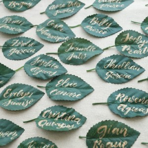 Place cards calligraphy for a Teddy Manuel wedding gold paint on leaves
