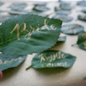 Place cards calligraphy for a Teddy Manuel wedding gold paint on leaves bride
