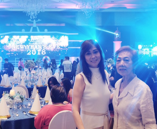 My mom and her mom, posing by our table at Sofitel's New Year Countdown