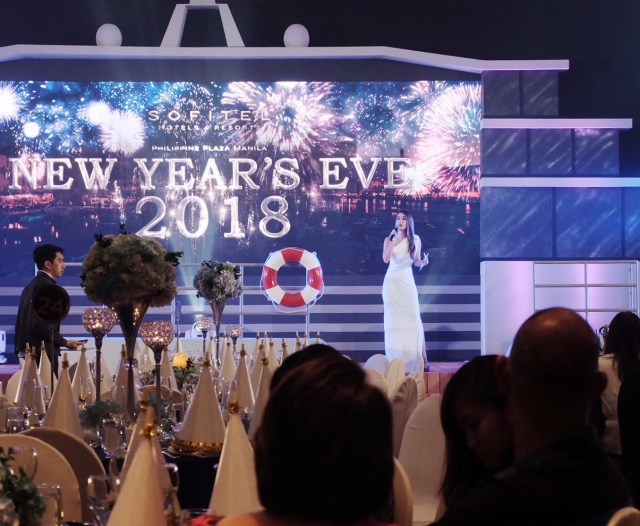My sister hosting the night away! Take a look at the stage area they transformed into a yacht!
