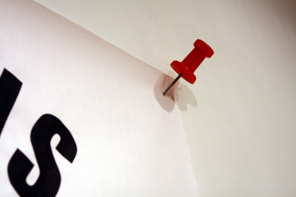 """Flier (detail: thumbtack)."" Installation view, SPACES, Cleveland, OH. 2010"