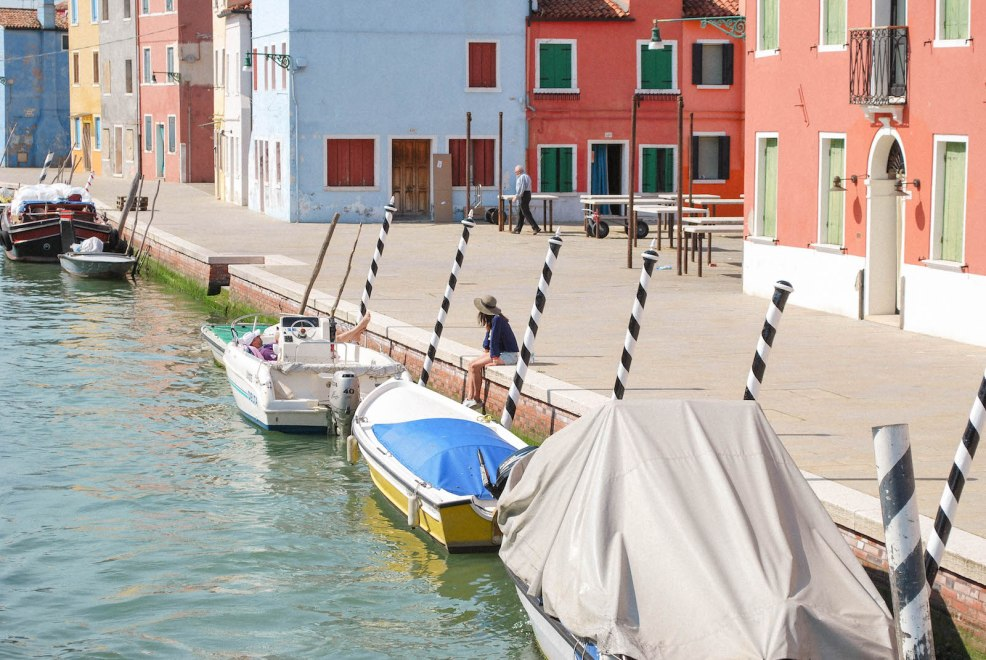 sitting by a canal in colourful Burano Italy