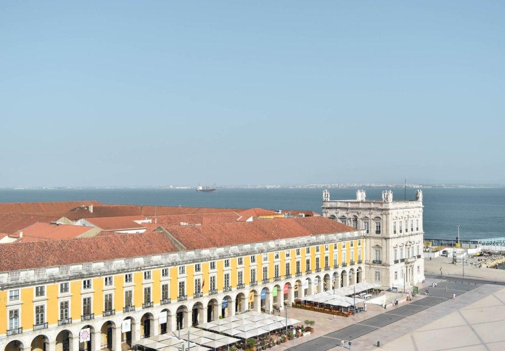 view of Praça do Comércio from rua Augusta arch in Lisbon Portugal