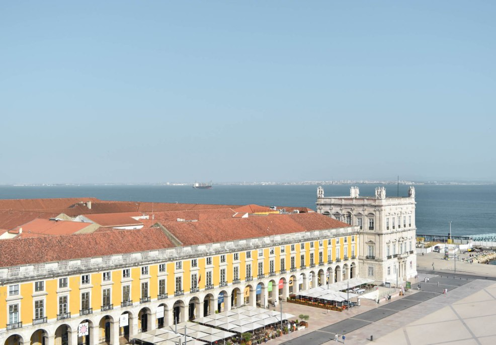 view of Praça do Comércio from rua Augusta arch in Lisbon Portugal